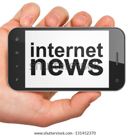 News concept: hand holding smartphone with word Internet News on display. Generic mobile smart phone in hand on White background. - stock photo