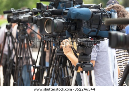News conference. Filming an event with a video camera. - stock photo