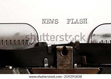 News flash written on an old typewriter - stock photo