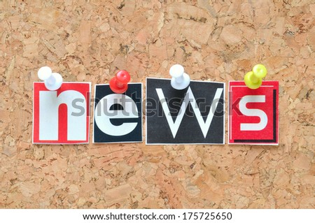 News lettering on cork background - stock photo