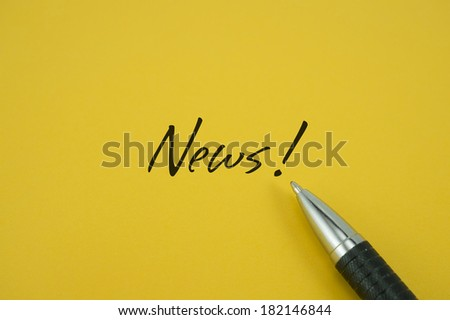 News! note with pen on yellow background - stock photo