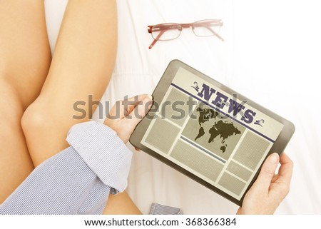 news on the digital device - stock photo