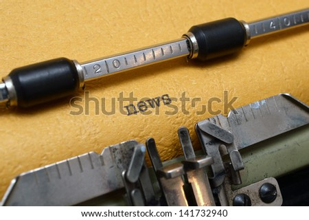 News on typewriter - stock photo