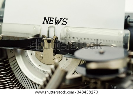 NEWS - Paper Sheets in Old Vintage Typewriter . Business concept on Toned, Grain Effect, Shallow Depth Of Field and Blurred Background - stock photo
