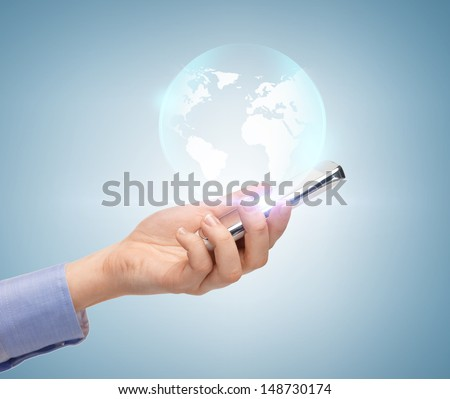 news, technology and environment concept - woman hand with sphere globe - stock photo