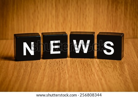 news text on black block, business concept - stock photo