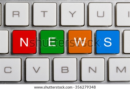 NEWS text on the colorful buttons of the keyboard. - stock photo