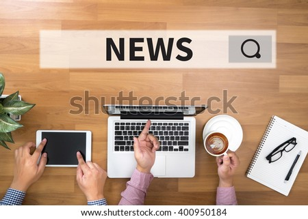 NEWS Two Businessman working at office desk and using a digital touch screen tablet and use computer - stock photo