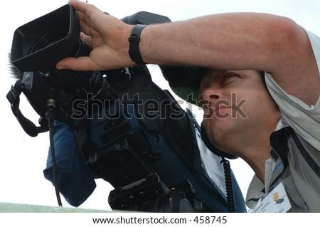 News Video Cameraman - stock photo