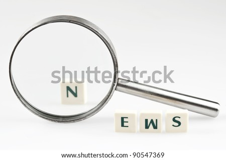 News word and magnifying glass - stock photo