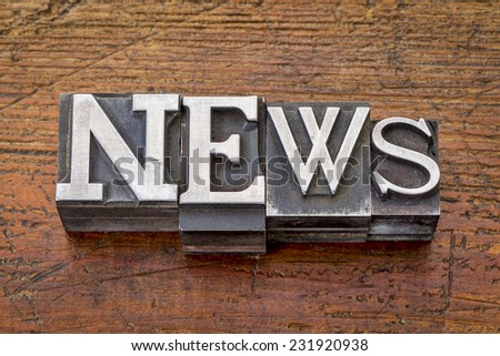 news word in vintage metal type printing blocks over grunge wood, mixed fonts in style and size - stock photo