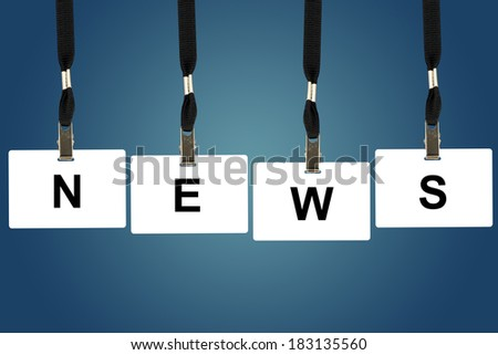 news word on badge with blue background - stock photo