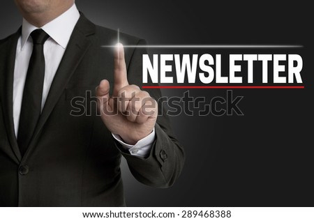Newsletter touchscreen is operated by businessman. - stock photo