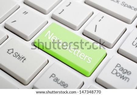 Newsletters on keyboard - stock photo