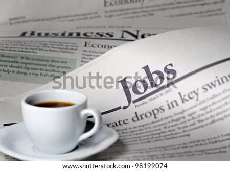 Newspaper and coffee with shallow depth of field - stock photo