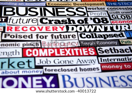 Newspaper and magazine headlines detailing the economic recession and recovery - stock photo