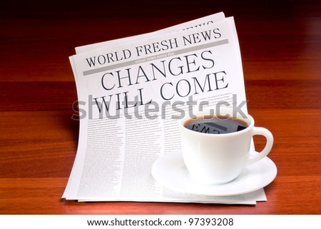 Newspaper CHANGES WILL COME and cup of coffee - stock photo