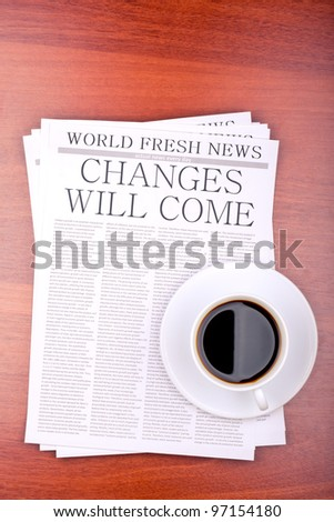 Newspaper CHANGES WILL COME and cup of coffee top view