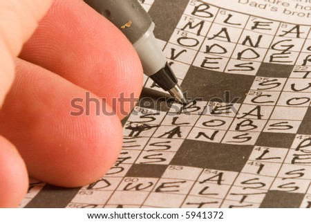 Newspaper crossword puzzle being solved by exercising the brain