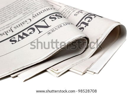 Newspaper detail on white background with shallow depth of field - stock photo