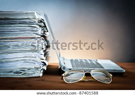newspaper,eyeglasses and laptop - stock photo
