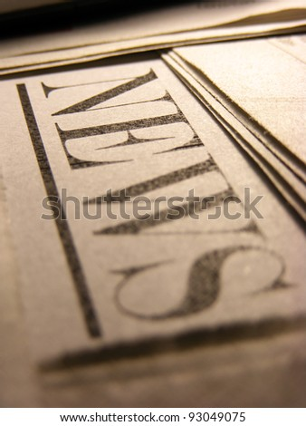 Newspaper in sepia style. Selective focus. - stock photo