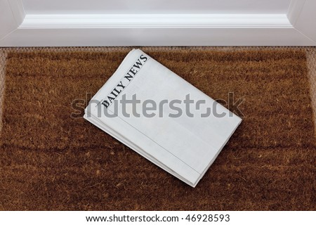 Newspaper lying on a doormat, blank to add your own text. Generic titles added by me. - stock photo