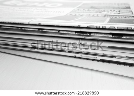 Newspaper on the wooden table - stock photo