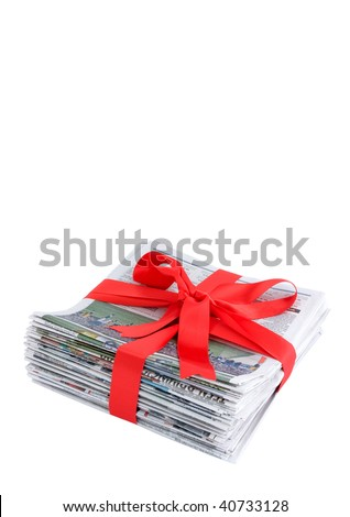 Newspaper stack with red bow - stock photo