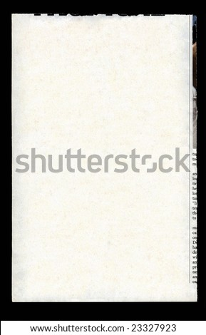 Newspaper tear isolated on black - stock photo
