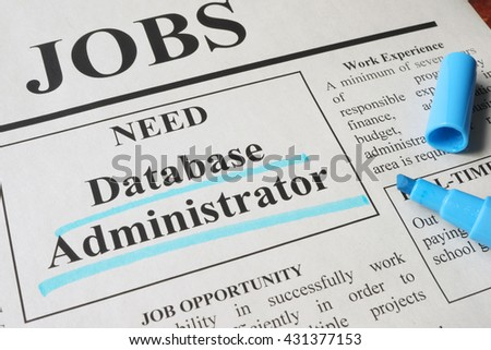 Newspaper with ads for vacancy database administrator. Employment concept.