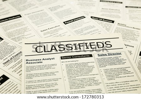 newspaper with advertisements and classifieds ads for vacancy, search for jobs