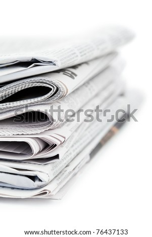 Newspapers and black glasses on a white a background - stock photo
