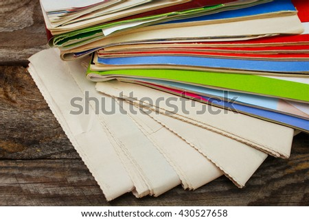 Newspapers and magazines on old wood background.  - stock photo