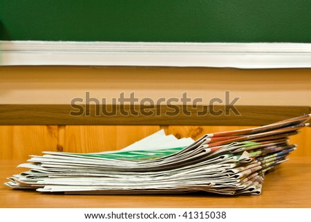 newspapers at school on a background a board - stock photo