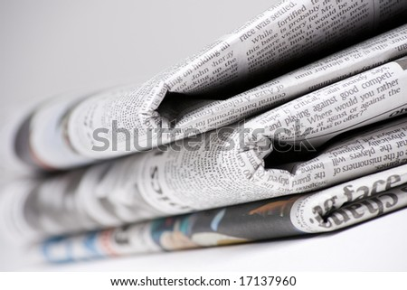 Newspapers on light background shot with very shallow depth of focus