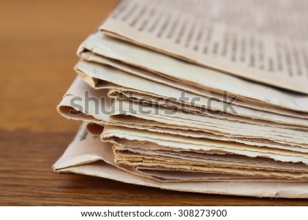 Newspapers on old wood background.  - stock photo