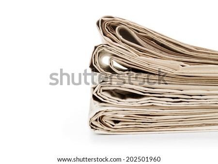 newspapers on plain background