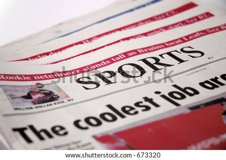 Newspapers showing Sports headline.