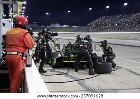 Newton Iowa, USA - July 12, 2014: Verizon Indycar Series Iowa Corn 300 Crew works rapidly on pit stop to refuel and change tires. 98 Jack Hawksworth (R) Integrity Energee Drink Honda