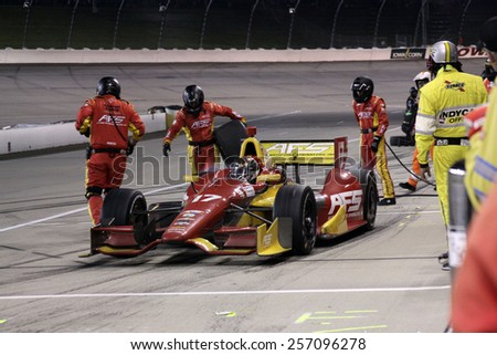 Newton Iowa, USA - July 12, 2014: Verizon Indycar Series Iowa Corn 300 17 Sebastian Saavedra Automatic Fire Sprinklers KV AFS Chevrolet, crew changes tires and adds fuel. Pit Stop
