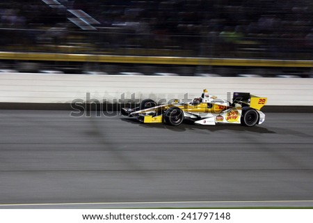 Newton Iowa, USA - June 23, 2012: Indycar Iowa Corn 250. Nightime racing action, under the lights, at Iowa Speedway. 28 Ryan Hunter-Reay Ft. Lauderdale, Fla. Team DHL/Sun Drop Citrus Soda Race Winner