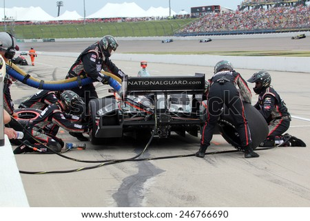 Newton Iowa, USA - June 23, 2013: Indycar Iowa Corn 250 race Iowa Speedway, pit stop sequence action. Crew for Oriol Servia, National Guard, Panther racing - stock photo