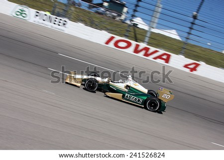 Newton Iowa, USA - June 22, 2012: Indycar Iowa Corn 250. Racing action at Iowa Speedway. 20 Ed Carpenter Indianapolis Fuzzy?s Vodka / Ed Carpenter Racing - stock photo