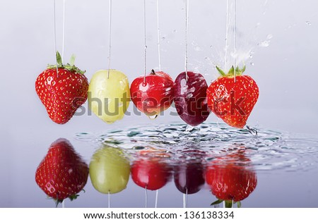 Newton's balls made from fruits. - stock photo