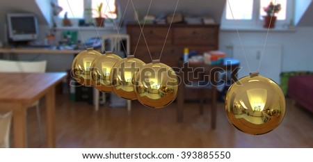 Newton's Cradle - Golden 3D Pendulum with Single Apartment Interior Background.Perspectively Hanging Pendulum, Polished and with Reflection on Surface. Gold Colored Spheres - Closeup. - stock photo