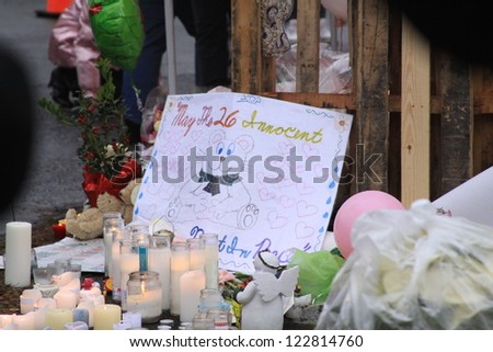 NEWTOWN, CT., USA, DEC 16, 2012: Sandy Hook Elementary School shooting, Memorial sign with assorted gifts, Dec 16, 2012 in Newtown, CT., USA - stock photo