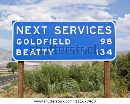 Next services sign in the middle on nowhere.