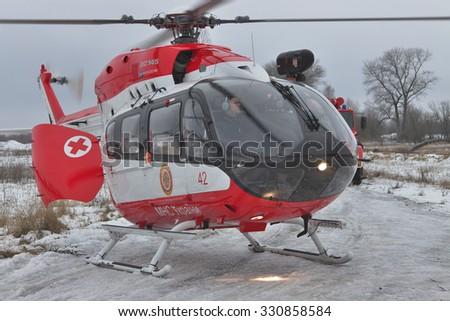 Nezhin, Ukraine - January 14, 2011: Ukrainian Ministry of Emergency Situations Eurocopter EC145 (BK-117) rescue helicopter  - stock photo