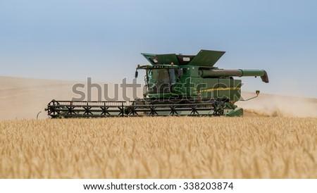 NEZPERCE, IDAHO/USA  AUGUST 9, 2015: John Deere S690 combine harvesting a field of wheat in Idaho. - stock photo